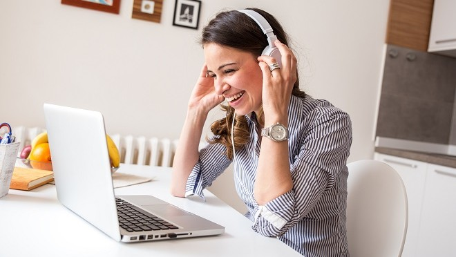 Woman working remotely talking to the rest of her team- Hays Viewpoint, careers advice blog