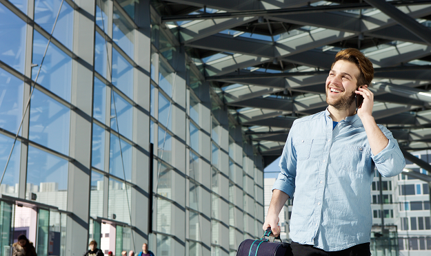 Young professional arrived to an airport and looks forward to his international job - Hays Viewpoint, careers advice blog