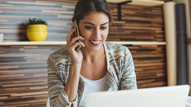 Women getting call from recruiter about ideal job vacancy-- Hays Viewpoint, careers advice blog