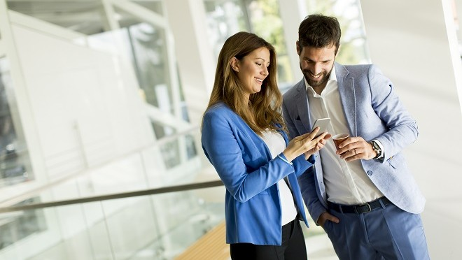Two HR professionals using technology to find candidates - Hays Viewpoint, careers advice blog