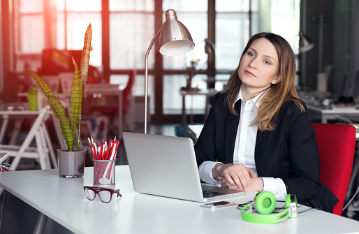Employee thinking about how to get promoted - Hays careers advice