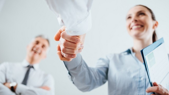 Hiring manager shaking hands with a productive candidate - Hays careers advice